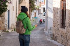 Woman tourist is looking at the map royalty free stock photo