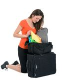 Woman tourist looking for something in baggage Stock Photography