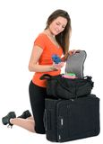 Woman tourist looking for something in baggage Royalty Free Stock Photography