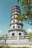 Woman tourist looks at Asian pagoda Stock Image
