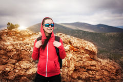 Woman tourist looks for way from the rocks top Stock Image