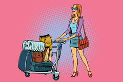 Woman tourist with Luggage cart Stock Image