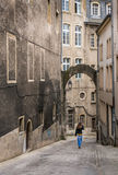 Woman tourist in Luxembourg. Woman tourist walking down a beautiful cobblestone street in Luxembourg City Stock Image