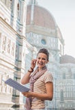 Woman tourist with map having audio walking tour, Florence Stock Photos