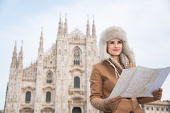 Woman tourist with map looking aside in the front of Duomo Royalty Free Stock Images
