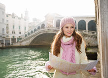 Woman tourist with map near Rialto Bridge looking into distance Stock Photo