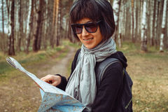Woman tourist with map Stock Photography