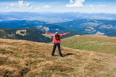 Woman tourist on the mountain Stock Image