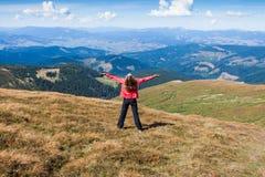 Woman tourist on the mountain Stock Image