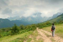 Woman tourist in mountain stock photos
