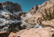 Tourist near Emerald Lake in Colorado. Woman tourist near Emerald Lake at autumn in Rocky Mountain National Park. Colorado, USA Stock Image