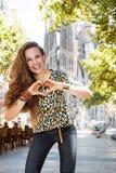 Woman tourist near Sagrada Familia showing heart shaped hands Stock Image