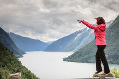 Woman tourist in norwegian mountains fjords Royalty Free Stock Image