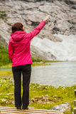 Woman tourist in norwegian mountains Royalty Free Stock Photo