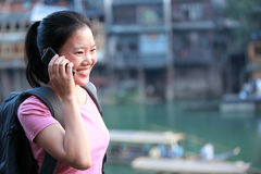 Woman tourist on the phone Stock Image