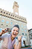Woman tourist with photo camera showing thumbs up, Florence Royalty Free Stock Image