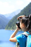 Woman tourist/photographe r taking photo Stock Image