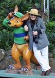 Woman tourist posing with kangaroo statue Gold Coast, Australia Stock Image