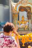 Woman tourist praying at Erawan Shrine Stock Photos