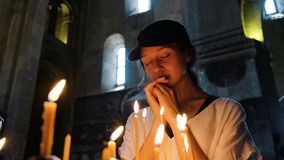 Woman tourist praying in a large orthodox church.  stock footage