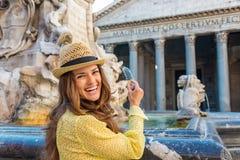 Woman tourist preparing coin to throw in Pantheon fountain Stock Photos