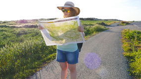 Woman tourist read the map. stock video footage