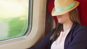 Woman tourist relaxing in high-speed international train. Traveling in Europe. High speed, shaking. Woman tourist traveling in Europe by train. Young female stock footage