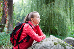 Woman tourist relaxing on nature Stock Images
