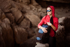 Woman tourist in the rocky grot Royalty Free Stock Photos