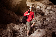 Woman tourist in the rocky grot. Tourist in the rocky grot Royalty Free Stock Photos