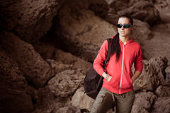 Woman tourist in the rocky grot. Tourist in the rocky grot Stock Photos