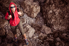 Woman tourist in the rocky grot. Tourist in the rocky grot Stock Photography