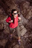 Woman tourist in the rocky grot. top view. Tourist in the rocky grot Royalty Free Stock Photography
