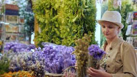 Woman tourist selects a bouquet of flowers in a famous flower market in the center of Amsterdam. 4K video stock video