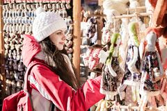 Woman tourist selects souvenir in market Stock Photos