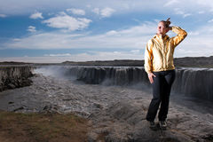 Woman tourist with Selfoss waterfall in background Royalty Free Stock Photos