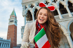 Woman tourist showing Italian flag on Piazza San Marco in Venice Stock Image