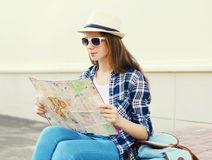 Woman tourist sightseeing city with paper map Stock Photography