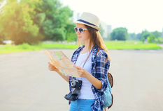 Woman tourist sightseeing city with paper map in summer Royalty Free Stock Image