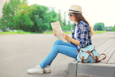Woman tourist sightseeing city with paper map Stock Images