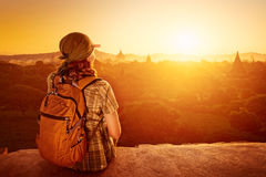 Woman tourist sit on sunset and enjoy the view. Stock Photo