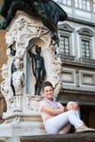 Woman tourist sitting in Loggia dei Lanzi in Florence, Italy Stock Image