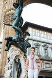 Woman tourist standing in Loggia dei Lanzi in Florence, Italy Stock Photo