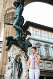Woman tourist standing in Loggia dei Lanzi in Florence, Italy Stock Image