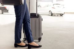 Woman tourist standing with luggage waiting for taxi Stock Images