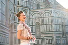 Woman tourist standing near Duomo and looking into distance Royalty Free Stock Photos