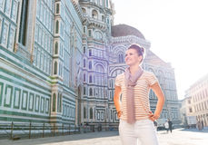 Woman tourist standing near Duomo and looking into distance Royalty Free Stock Image
