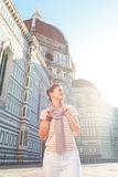 Woman tourist standing near Duomo and looking into distance Royalty Free Stock Images