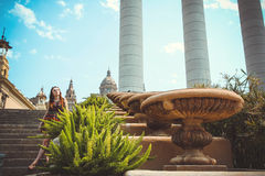 Woman tourist is standing near National Museum of Catalan Art (MNAC) in Barcelona Royalty Free Stock Image