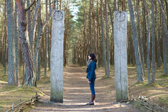 Woman tourist standing in the woods at the entrance   Royalty Free Stock Photos